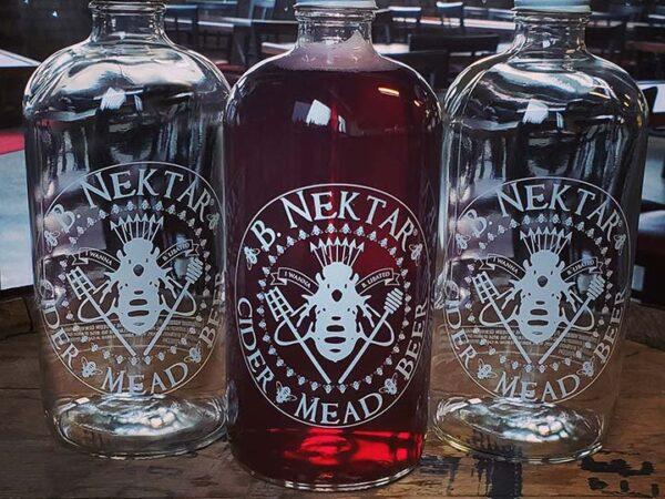 Refillable 32oz. glass B. Nektar branded Howler